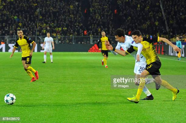 Dele Alli of Tottenham Hotspur and Marc Bartra Aregall of Borussia Dortmund battle for the ball during the UEFA Champions League group H match...