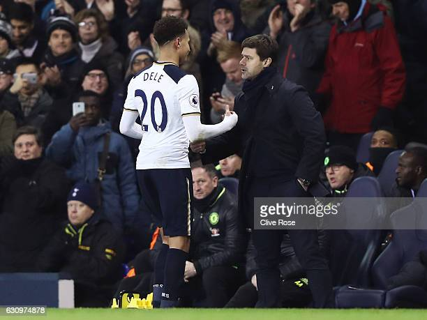 Dele Alli of Tottenham Hotspur and Mauricio Pochettino Manager of Tottenham Hotspur embrace after he is subbed during the Premier League match...