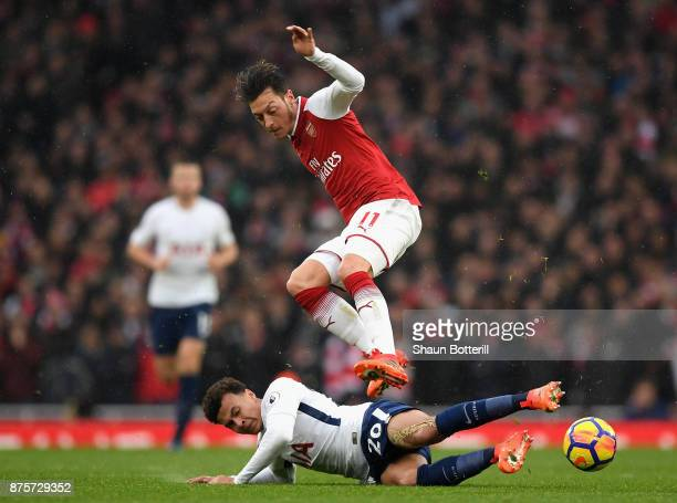 Dele Alli of Tottenham Hotspur and Mesut Ozil of Arsenal in action during the Premier League match between Arsenal and Tottenham Hotspur at Emirates...