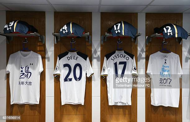 Dele Alli of Tottenham Hotspur and Moussa Sissoko of Tottenham Hotspur shirts hang in the changing room with Chinese New Year warmup shirts prior to...