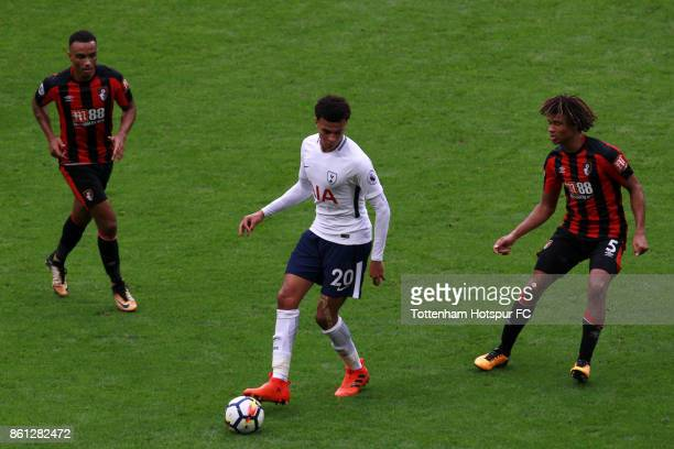 Dele Alli of Tottenham Hotspur and Nathan Ake of AFC Bournemouth in action during the Premier League match between Tottenham Hotspur and AFC...