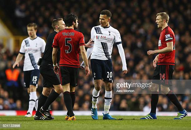 Dele Alli of Tottenham Hotspur argues with Claudio Yacob of West Bromwich Albion as referee Mike Jones intervenes during the Barclays Premier League...