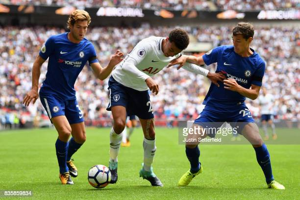 Dele Alli of Tottenham Hotspur attempts to get past Andreas Christensen of Chelsea and Marcos Alonso of Chelsea during the Premier League match...