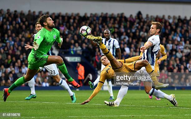 Dele Alli of Tottenham Hotspur attempts to score past Ben Foster of West Bromwich Albion but shot goes wide during the Premier League match between...