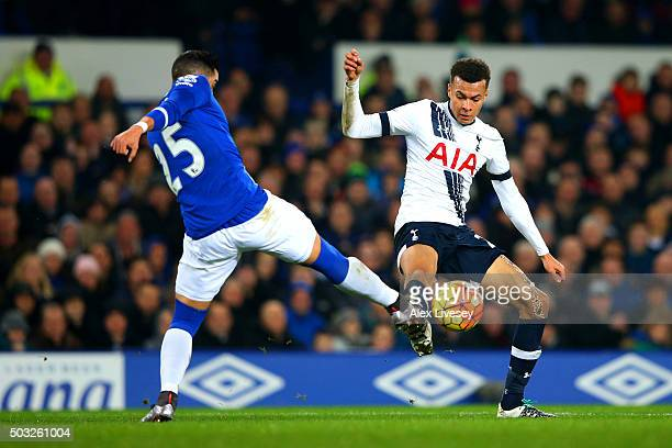 Dele Alli of Tottenham Hotspur battles for the ball with Ramiro Funes Mori of Everton during the Barclays Premier League match between Everton and...