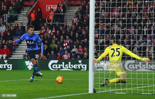 Dele Alli of Tottenham Hotspur beats goalkeeper Paulo Gazzaniga of Southampton to score their second goal during the Barclays Premier League match...