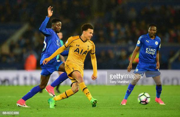 Dele Alli of Tottenham Hotspur beats Wilfred Ndidi of Leicester City to the ball during the Premier League match between Leicester City and Tottenham...