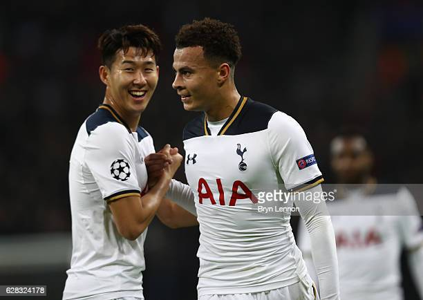 Dele Alli of Tottenham Hotspur celebrates scoring his sides first goal with HeungMin Son of Tottenham Hotspur during the UEFA Champions League Group...