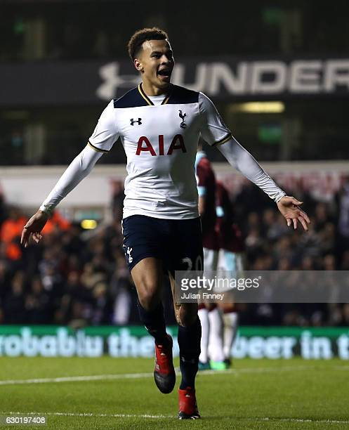Dele Alli of Tottenham Hotspur celebrates scoring his sides first goal during the Premier League match between Tottenham Hotspur and Burnley at White...