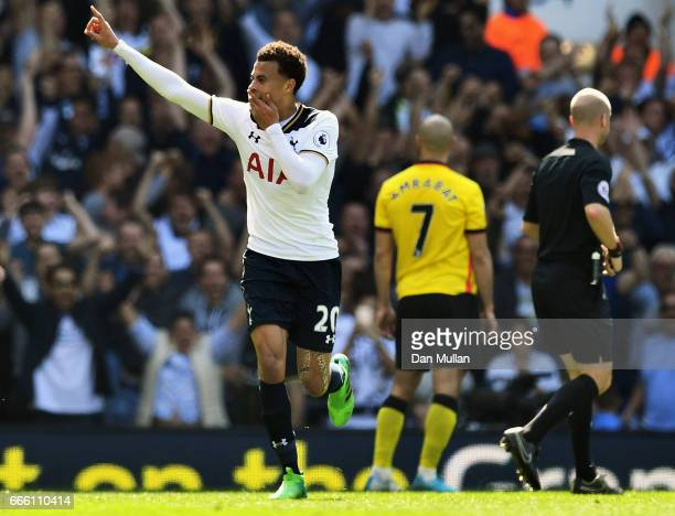 Dele Alli of Tottenham Hotspur celebrates scoring his sides first goal during the Premier League match between Tottenham Hotspur and Watford at White...