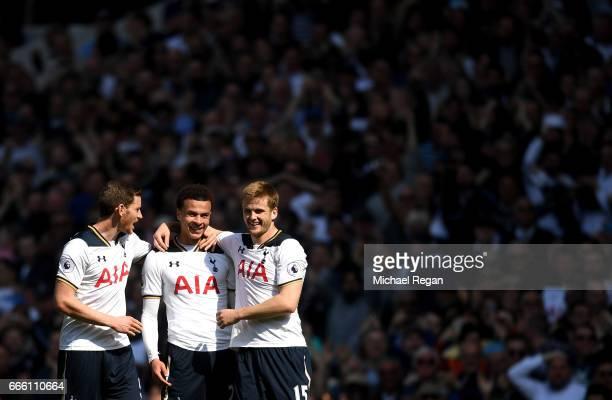 Dele Alli of Tottenham Hotspur celebrates scoring his sides first goal with Jan Vertonghen of Tottenham Hotspur and Eric Dier of Tottenham Hotspur...