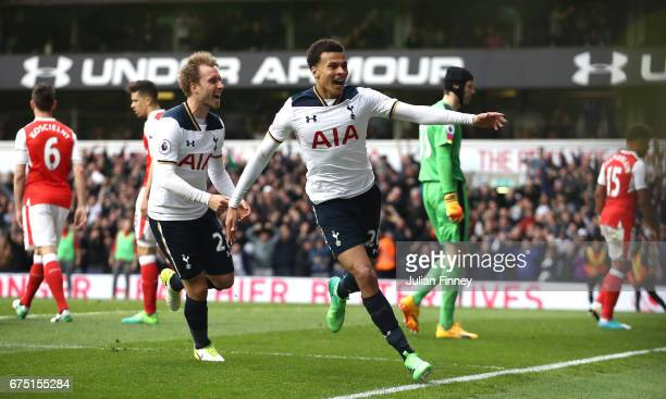 Dele Alli of Tottenham Hotspur celebrates scoring his sides first goal during the Premier League match between Tottenham Hotspur and Arsenal at White...