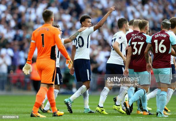 Dele Alli of Tottenham Hotspur celebrates scoring his sides first goal during the Premier League match between Tottenham Hotspur and Burnley at...