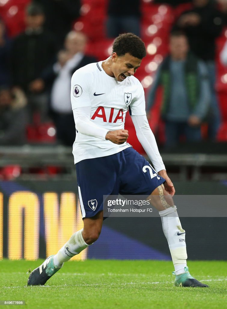 Dele Alli of Tottenham Hotspur celebrates scoring his sides first goal during the Carabao Cup Third Round match between Tottenham Hotspur and Barnsley at Wembley Stadium on September 19, 2017 in London, England.
