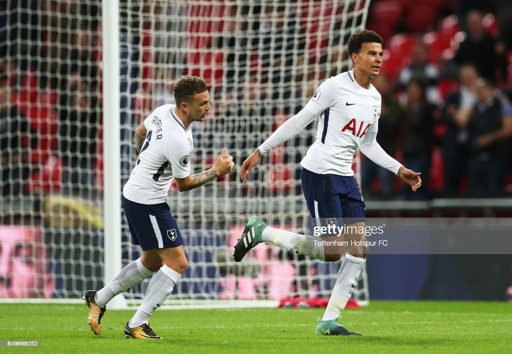 Dele Alli of Tottenham Hotspur celebrates scoring his sides first goal with Kieran Trippier of Tottenham Hotspur during the Carabao Cup Third Round match between Tottenham Hotspur and Barnsley at Wembley Stadium on September 19, 2017 in London, England.