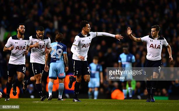 Dele Alli of Tottenham Hotspur celebrates scoring his side's third goal with his tam mate Harry Winks during the Emirates FA Cup Fourth Round match...