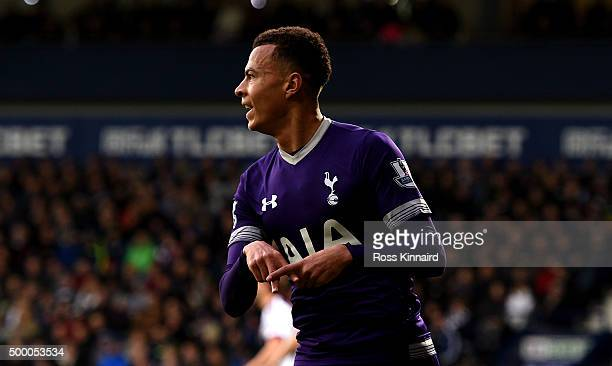 Dele Alli of Tottenham Hotspur celebrates scoring his team's first goal during the Barclays Premier League match between West Bromwich Albion and...