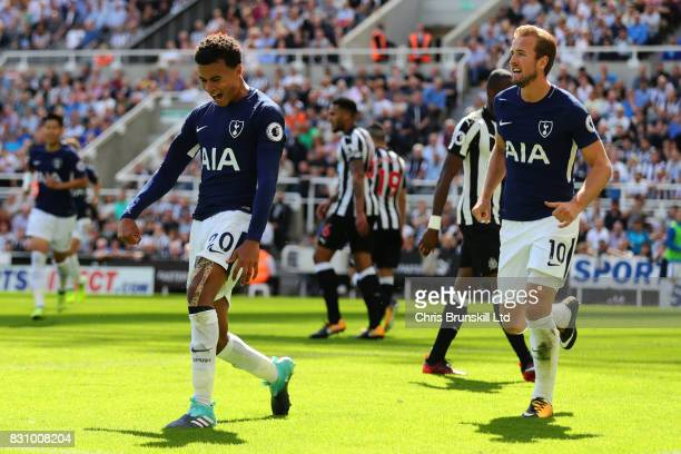 Dele Alli of Tottenham Hotspur celebrates scoring his team's first goal during the Premier League match between Newcastle United and Tottenham...