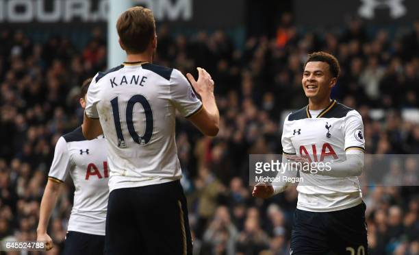 Dele Alli of Tottenham Hotspur celebrates scoring his teams fourth goal with teammate Harry Kane during the Premier League match between Tottenham...
