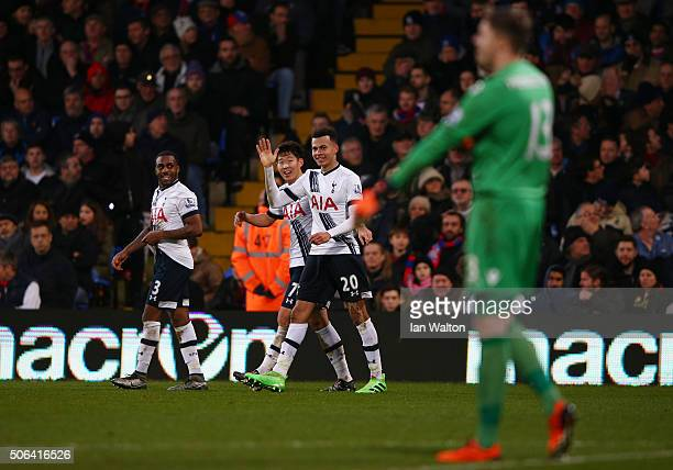 Dele Alli of Tottenham Hotspur celebrates scoring his team's second goal with his team mates Danny Rose and Son Heungmin during the Barclays Premier...