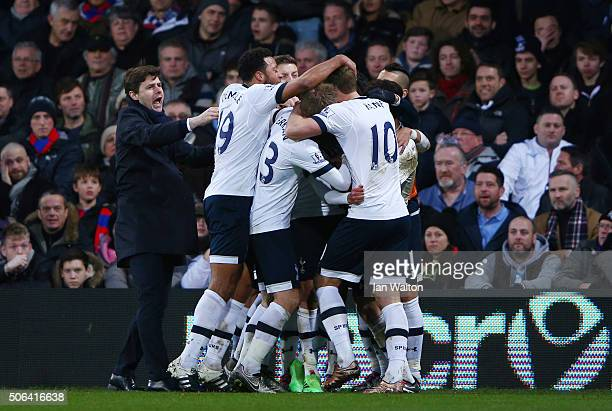 Dele Alli of Tottenham Hotspur celebrates scoring his team's second goal with his team mates and Mauricio Pochettino during the Barclays Premier...