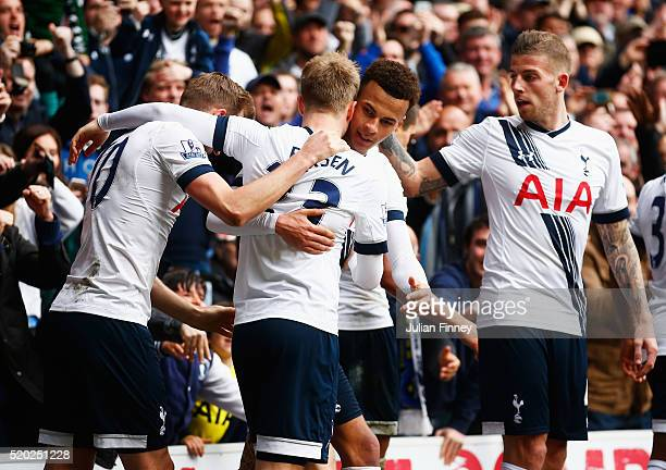 Dele Alli of Tottenham Hotspur celebrates with team mates as he scores their first goal during the Barclays Premier League match between Tottenham...