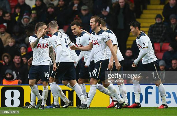 Dele Alli of Tottenham Hotspur celebrates with team matesas he scores their fourth goal during the Premier League match between Watford and Tottenham...