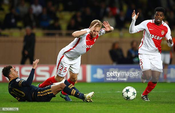 Dele Alli of Tottenham Hotspur challenges Kamil Glik of AS Monaco for the ball during the UEFA Champions League Group E match between AS Monaco FC...