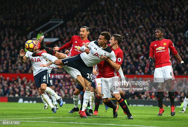 Dele Alli of Tottenham Hotspur competes for the ball against m36a and Zlatan Ibrahimovic of Manchester United during the Premier League match between...