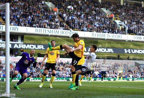 Dele Alli of Tottenham Hotspur competes for the ball with Daryl Janmaat of Watford during the Premier League match between Tottenham Hotspur and...