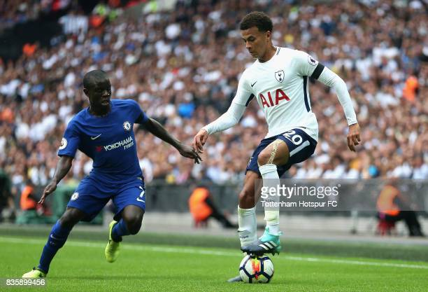 Dele Alli of Tottenham Hotspur controlls the ball under pressure from N'Golo Kante of Chelsea during the Premier League match between Tottenham...