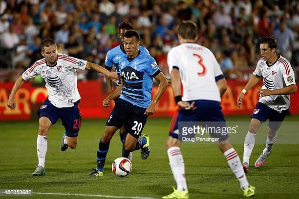 Dele Alli of Tottenham Hotspur controls the ball against Sam Cronin and Drew Moor of MLS AllStars during the 2015 ATT Major League Soccer AllStar...
