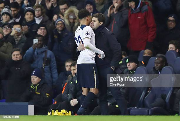 Dele Alli of Tottenham Hotspur embraces Mauricio Pochettino Manager of Tottenham Hotspur after he is subbed during the Premier League match between...