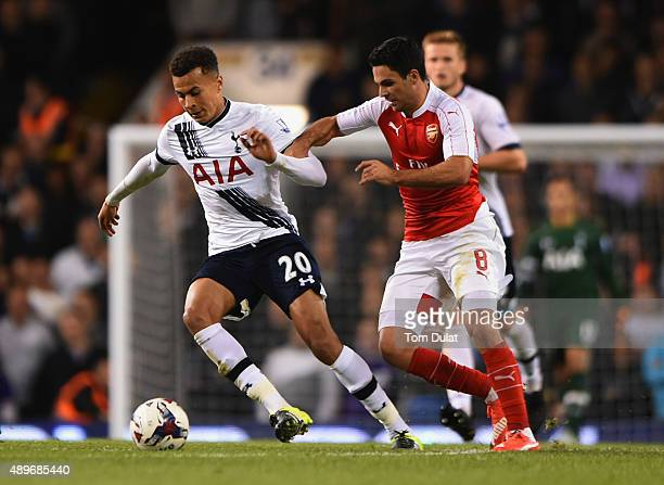 Dele Alli of Tottenham Hotspur evades Mikel Arteta of Arsenal during the Capital One Cup third round match between Tottenham Hotspur and Arsenal at...