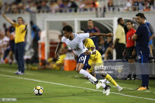 Dele Alli of Tottenham Hotspur gets fouled by Presnel Kimpembe of Paris SaintGermain during the International Champions Cup 2017 match between Paris...