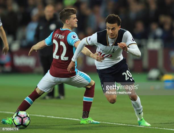 Dele Alli of Tottenham Hotspur goes past the challenge from Sam Byram of West Ham United during the Premier League match between West Ham United and...