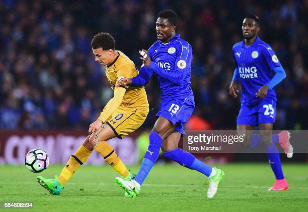 Dele Alli of Tottenham Hotspur holds off Daniel Amartey of Leicester City during the Premier League match between Leicester City and Tottenham...
