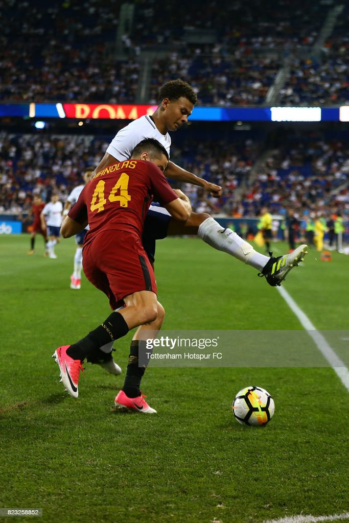 Dele Alli #20 of Tottenham Hotspur in action against Konstantinos Manolas #44 of Roma during the International Champions Cup 2017 at Red Bull Arena on July 25, 2017 in Harrison, New Jersey.
