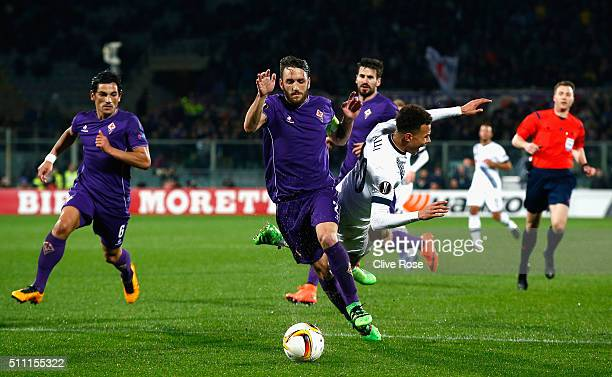 Dele Alli of Tottenham Hotspur is challenged by Gonzalo Rodriguez of Fiorentina during the UEFA Europa League round of 32 first leg match between...