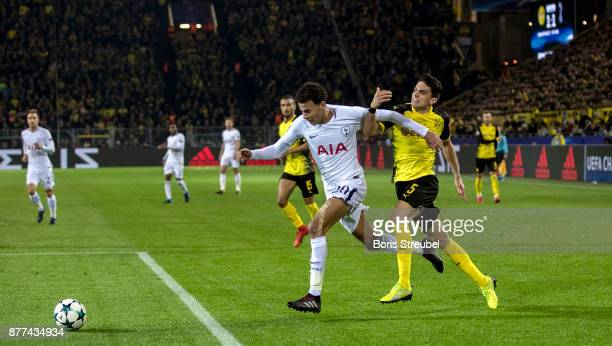Dele Alli of Tottenham Hotspur is challenged by Marc Bartra of Borussia Dortmund during the UEFA Champions League group H match between Borussia...