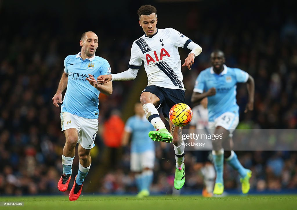 <a gi-track='captionPersonalityLinkClicked' href=/galleries/search?phrase=Dele+Alli&family=editorial&specificpeople=9976958 ng-click='$event.stopPropagation()'>Dele Alli</a> of Tottenham Hotspur is closed down by Pablo Zabaleta of Manchester City during the Barclays Premier League match between Manchester City and Tottenham Hotspur at Etihad Stadium on February 14, 2016 in Manchester, England.