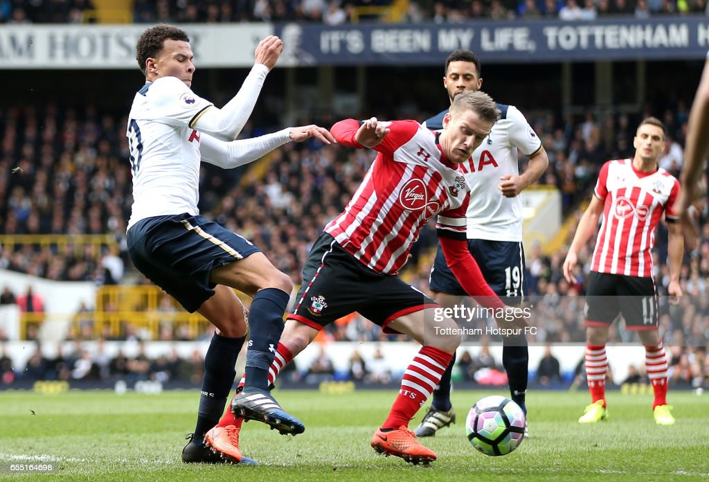 Dele Alli of Tottenham Hotspur (L) is fouled by Steven Davis of Southampton (R) which leads to a penalty for Tottenham Hotspur during the Premier League match between Tottenham Hotspur and Southampton at White Hart Lane on March 19, 2017 in London, England.