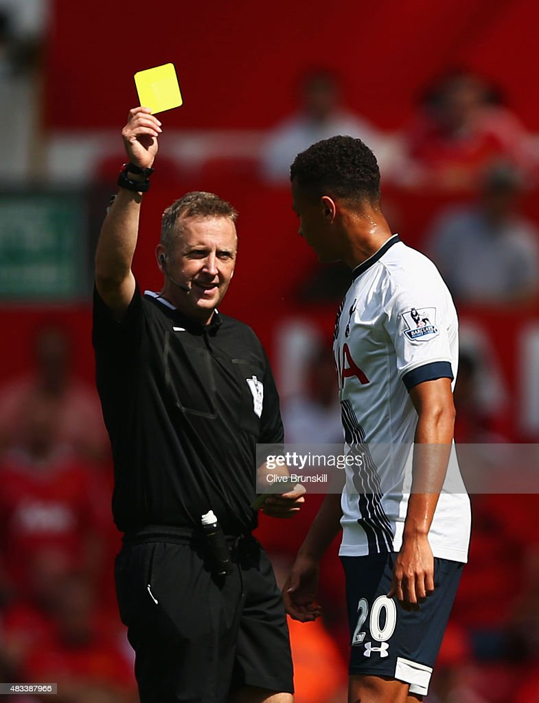 <a gi-track='captionPersonalityLinkClicked' href=/galleries/search?phrase=Dele+Alli&family=editorial&specificpeople=9976958 ng-click='$event.stopPropagation()'>Dele Alli</a> of Tottenham Hotspur is shown a yellow card by referee <a gi-track='captionPersonalityLinkClicked' href=/galleries/search?phrase=Jonathan+Moss+-+Arbitro+di+calcio&family=editorial&specificpeople=14630509 ng-click='$event.stopPropagation()'>Jonathan Moss</a> during the Barclays Premier League match between Manchester United and Tottenham Hotspur at Old Trafford on August 8, 2015 in Manchester, England.