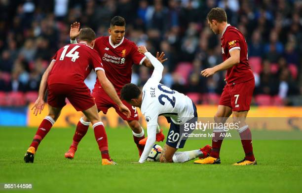 Dele Alli of Tottenham Hotspur is surrounded during the Premier League match between Tottenham Hotspur and Liverpool at Wembley Stadium on October 22...