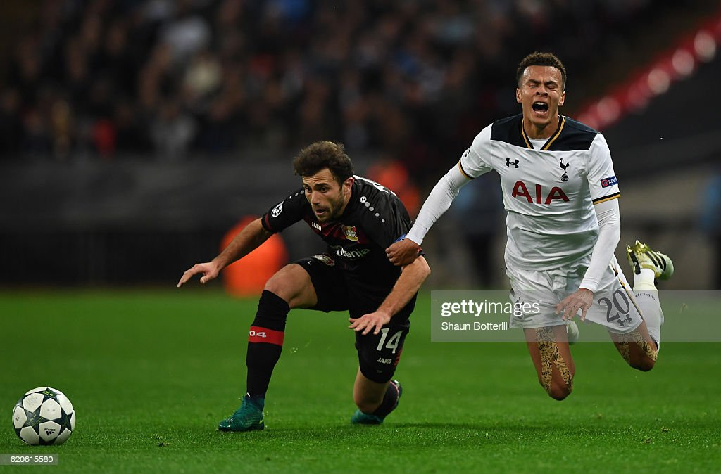 Dele Alli of Tottenham Hotspur is tackled by Admir Mehmedi of Bayer Leverkusen during the UEFA Champions League Group E match between Tottenham Hotspur FC and Bayer 04 Leverkusen at Wembley Stadium on November 2, 2016 in London, England.