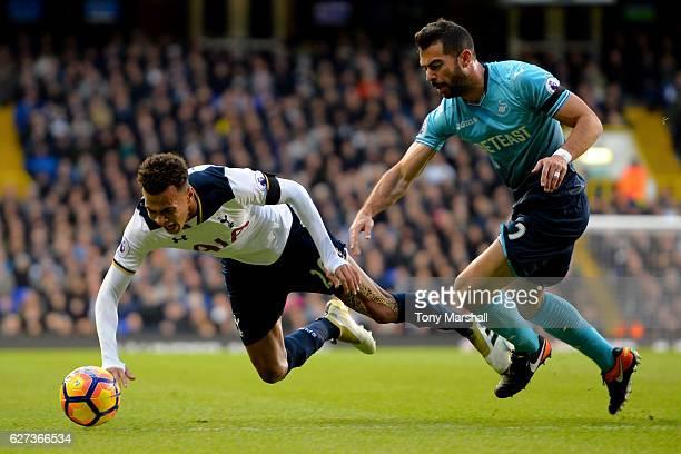 Dele Alli of Tottenham Hotspur is tackled by Jordi Amat of Swansea City during the Premier League match between Tottenham Hotspur and Swansea City at...