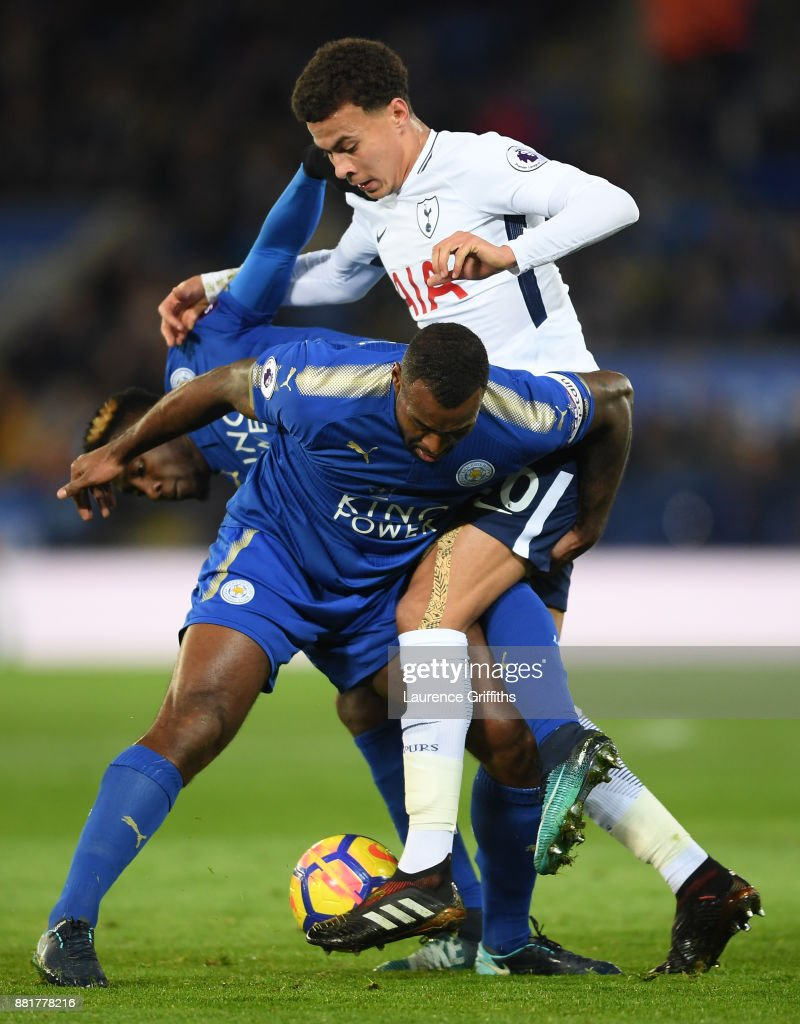 Dele Alli of Tottenham Hotspur is tackled by Wes Morgan of Leicester City during the Premier League match between Leicester City and Tottenham Hotspur at The King Power Stadium on November 28, 2017 in Leicester, England.