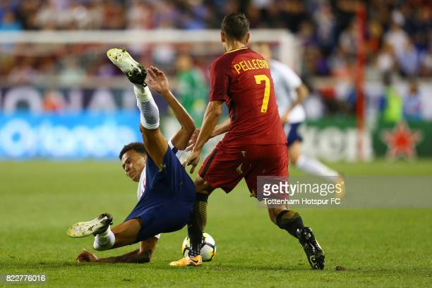 Dele Alli of Tottenham Hotspur is tripped up by Lorenzo Pellegrini of Roma during the International Champions Cup 2017 at Red Bull Arena on July 25...