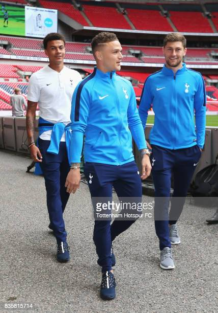Dele Alli of Tottenham Hotspur Kieran Trippier of Tottenham Hotspur and Ben Davies of Tottenham Hotspur all arrive at the stadium together prior to...