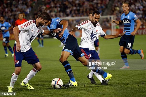 Dele Alli of Tottenham Hotspur looses control of the ball to Drew Moor and Juninho of MLS AllStars during the 2015 ATT Major League Soccer AllStar...